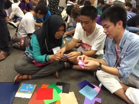 Folding peace origami together